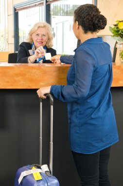 receptionist handing over  key card