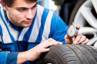 Mechanic, checking a measurement gauge
