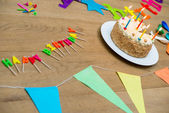 Birthday Cake And Decorations On Table