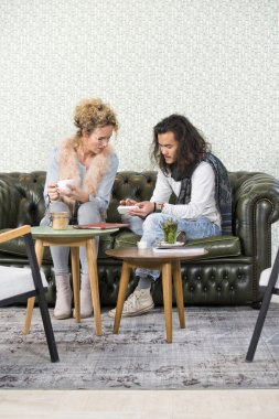 woman and man talking in lounge