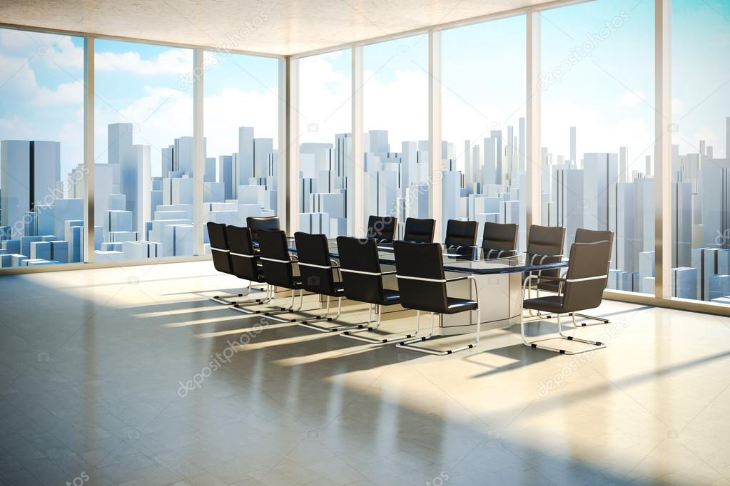 Modern office interior with beautiful worm daylight and city skyline in the background