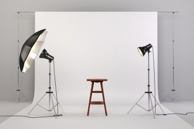 3d studio setup with lights, a wooden chair and white background