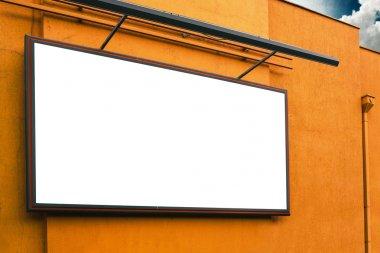 Blank advertising billboard on supermarket store exterior wall