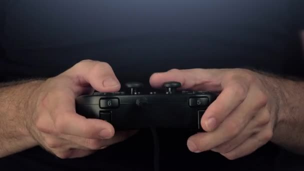 Time lapse of man playing video games with gamepad controller