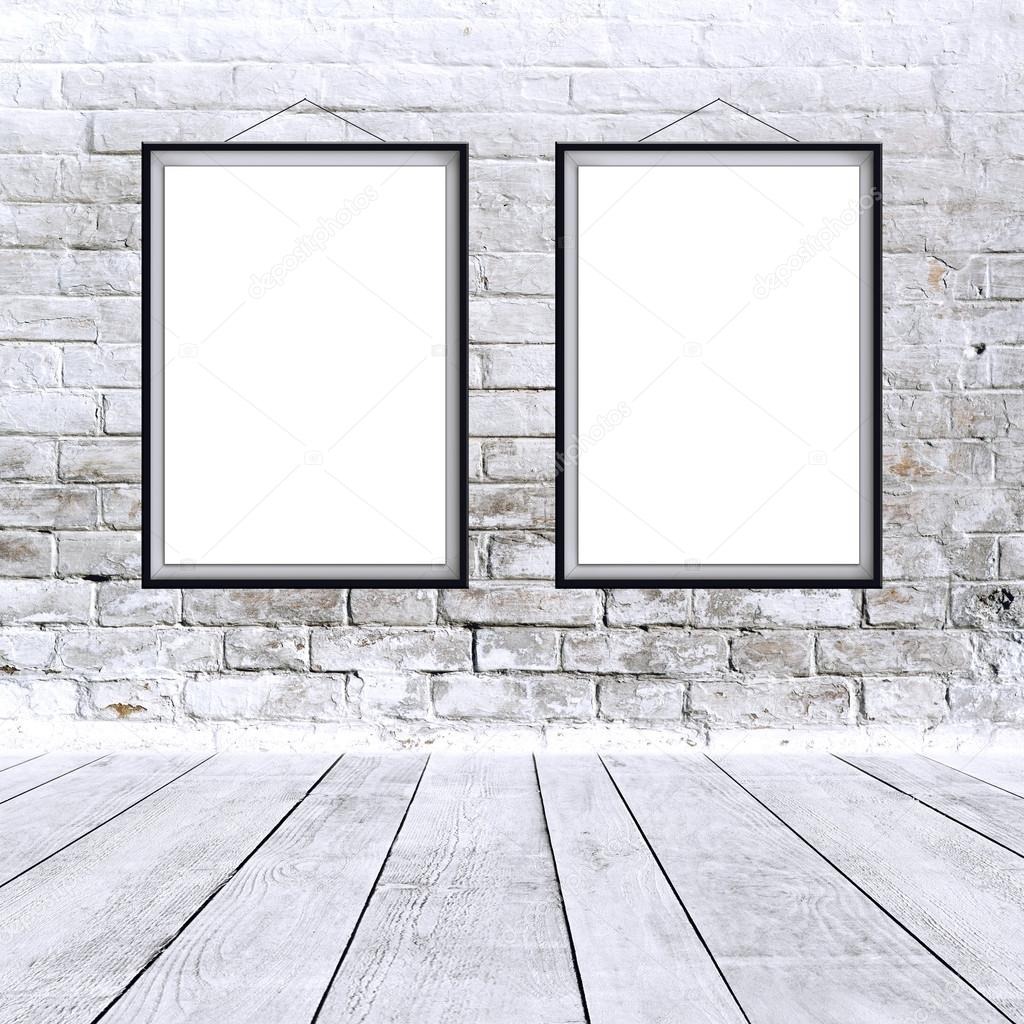 Two Blank Vertical Painting Poster In Black Frame Hanging On White Brick Wall Proportions Match International Paper Size A Photo By