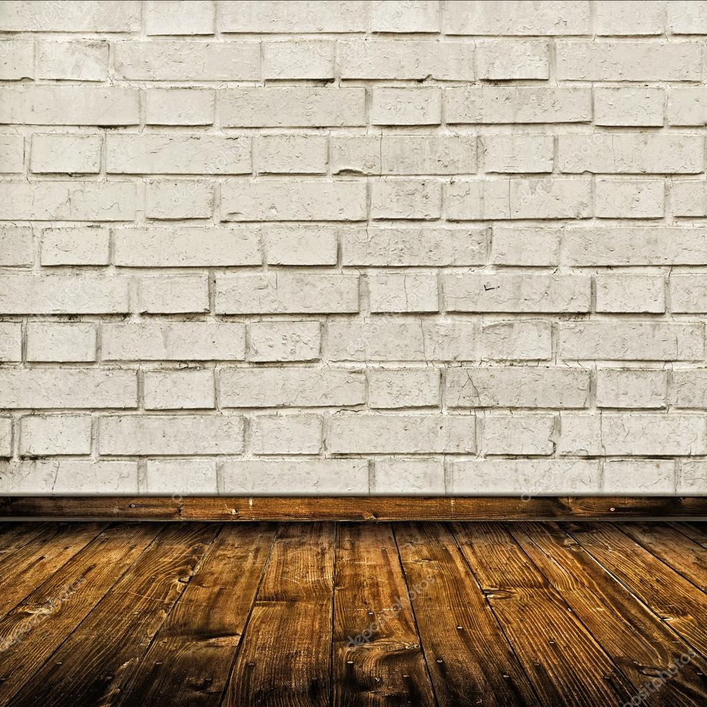Interior Da Sala Com Parede De Tijolo Branco E Piso De Madeira  -> Piso Parede Sala