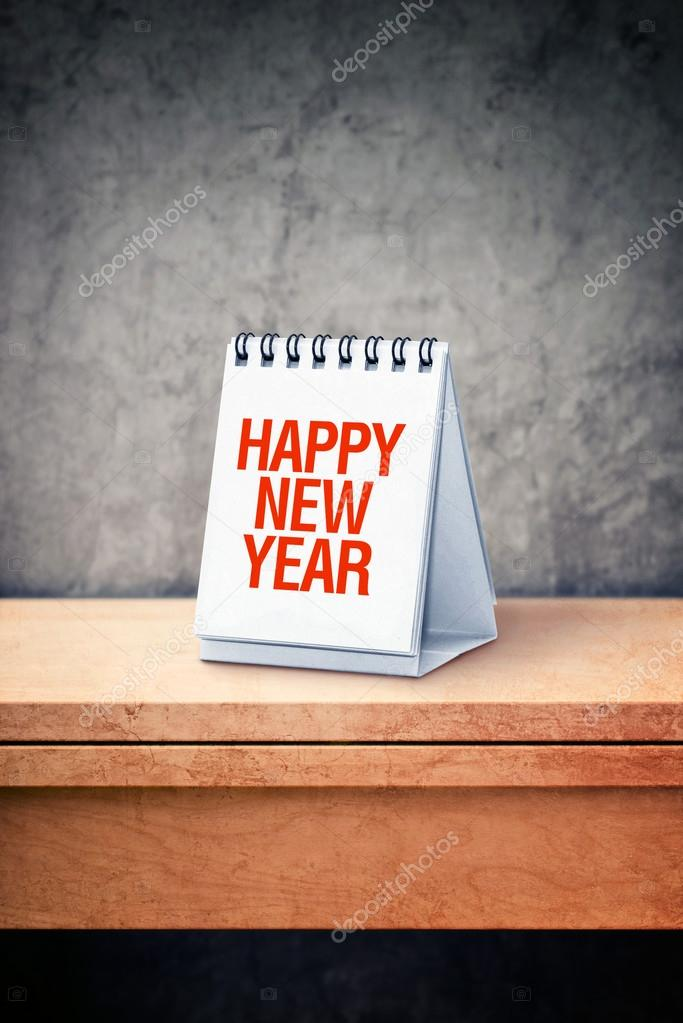Happy New Year on desk calendar at office table
