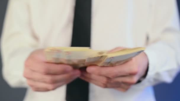 Businessman counting 50 euro banknotes money.
