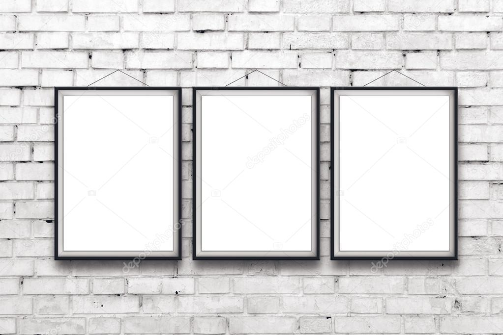Three Blank Vertical Painting Poster In Black Frame Hanging On White Brick Wall Proportions Match International Paper Size A Photo By