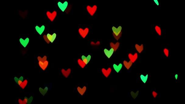 Barevné rozostření blikající srdce bokeh slavnostní světla jako abstraktní pozadí