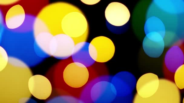 Colorful defocused lampeggiante luci festive bokeh come priorità bassa astratta