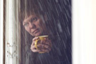 Lonesome Woman Drinking Coffee in Dark Room