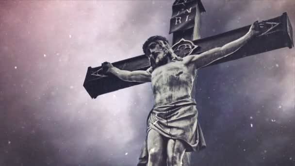 Crucifixion cross with Jesus Christ statue over stormy clouds and Snow falling