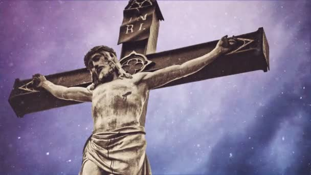 Crucifixion cross with Jesus Christ statue over stormy clouds and Snow falling time lapse as Religious Christian Concept.