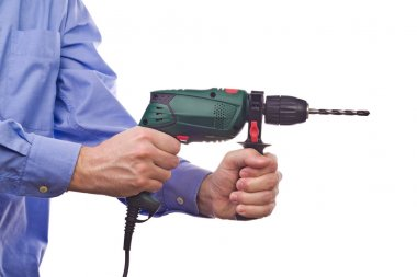 Male worker's hand holding electric handy drill