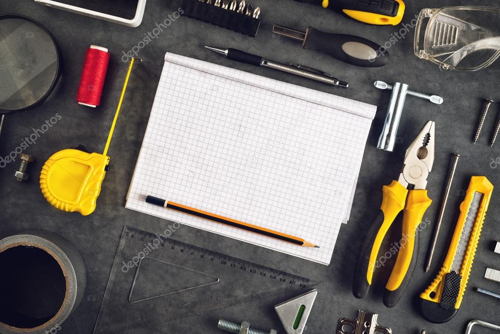 Assorted do it yourself tools and notebook stock photo assorted do it yourself diy tools and blank page notebook as copy space for home improvement project planning or any other workshop message solutioingenieria Gallery