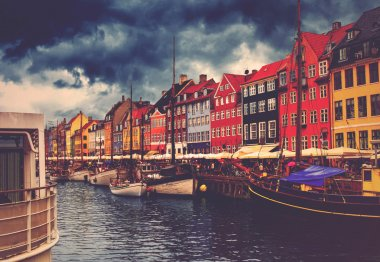 Copenhagen Nyhavn, Retro Toned Image of Canal and District with its Colorful Facades on Cloudy Spring Day, Beautiful Romantic Place in Denmark Capital stock vector