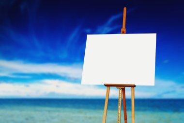 Easel with Blank Canvas on the Beach