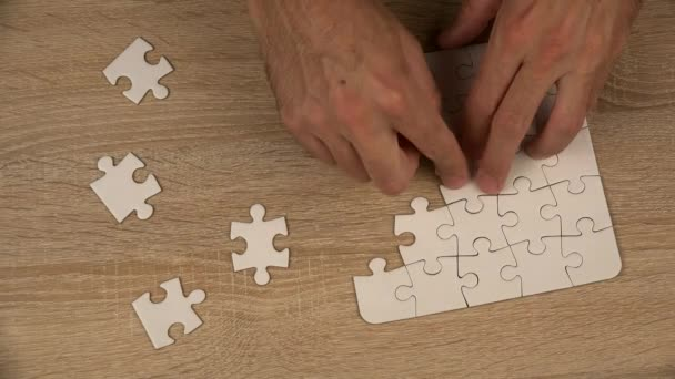 Man completing jigsaw puzzle