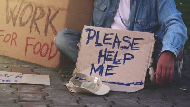 Homeless beggar asking for help