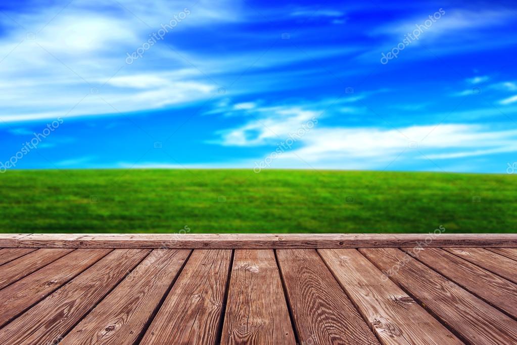 Rustic Wooden Boardwalk and Open Grassfield