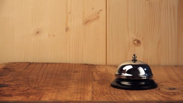 Woman ringing hotel reception bell