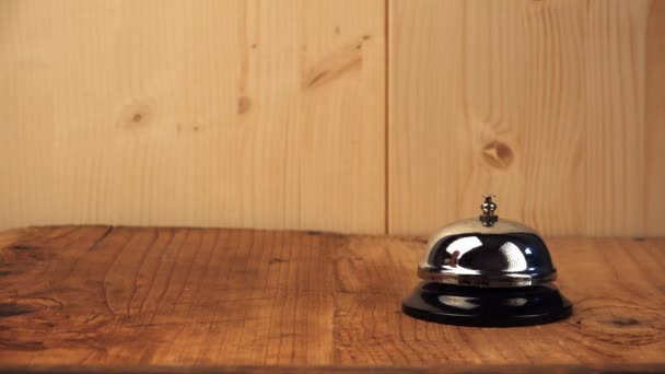 Angry woman ringing hotel reception bell