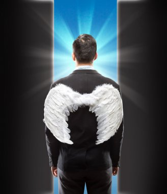 Businessman with wings on his back