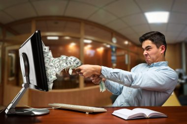 Businessman pulling out money