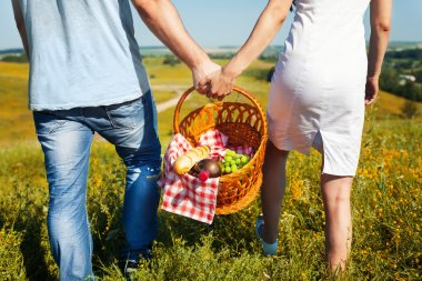 Young couple holding basket