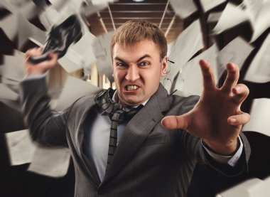 Crazy businessman fighting in office