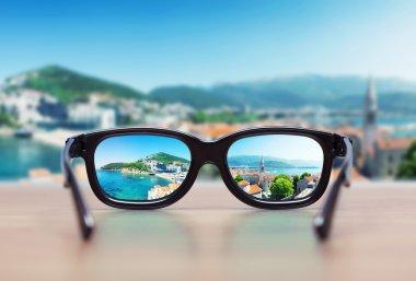 Cityscape focused in glasses lenses. Vision concept stock vector