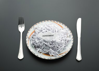 Heap of shredded papers on plate