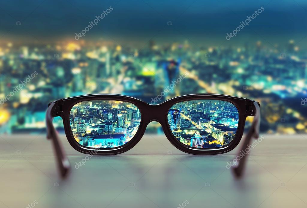 Фотообои Night cityscape focused in glasses lenses