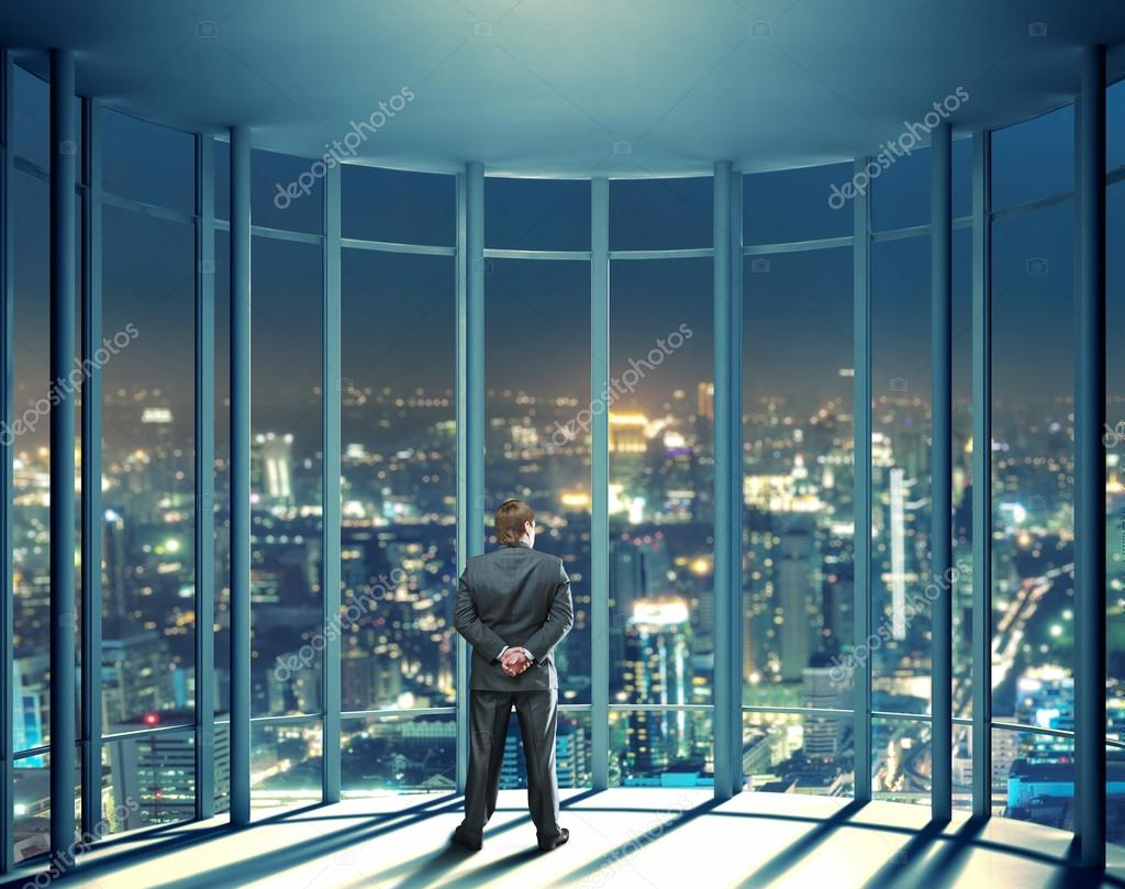 Man Looking Through Glass Window Stock Photo
