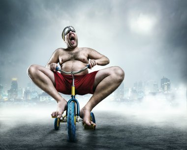 Man on child bicycle