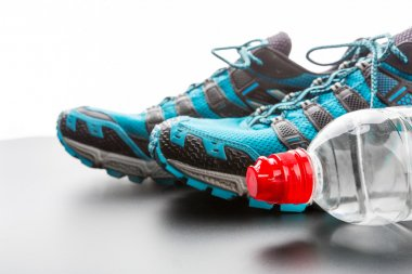 Sport shoes and water bottle