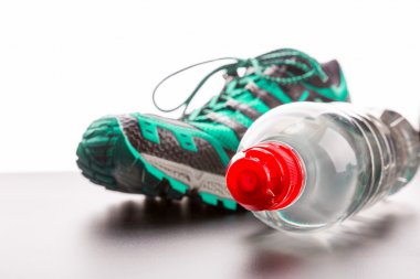 Sport shoe and water bottle