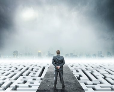Businessman standing on white labyrinth
