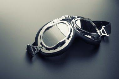 Pilot glasses on grey background stock vector