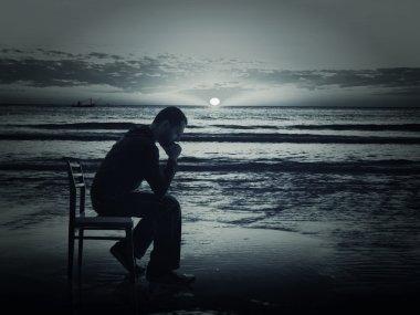 Pensive man on the coast