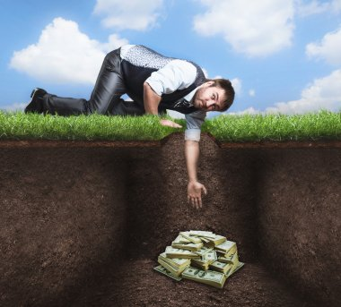 Businessman on knees tries to get treasure in the soil stock vector