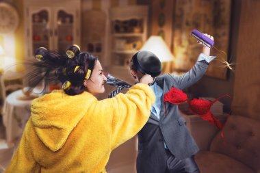Woman beats her husband