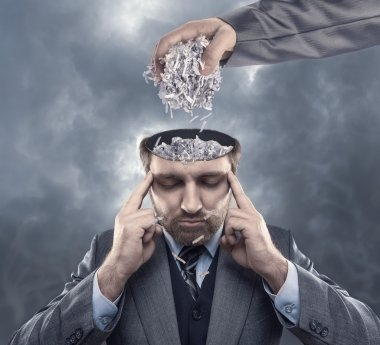 Man with paper in his brain