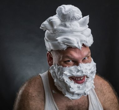 Man with shaving foam covered face
