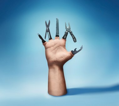 Human hand with various tools