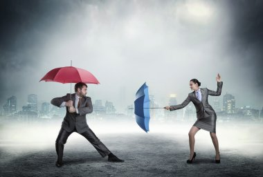 Business people fighting with umbrellas over cityscape in the night stock vector