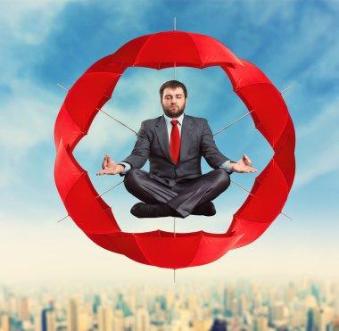 Businessman meditating in circle