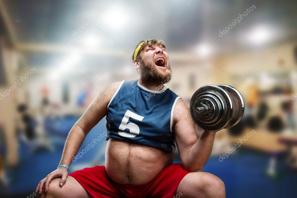 Fat man with dumbbell