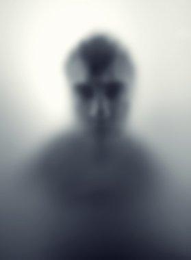 Man against steamed glass